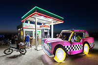 "Hani's Deep Playa Tax Refueling at Awful's Gas & Snack<br /> by: Matthew Gerring & Crank Factory<br /> from: San Francisco, CA<br /> year: 2019<br /> <br /> Awful's Gas & Snack: Your Gateway to the Big Wild! See one of the few remaining gasoline stations, painstakingly preserved since the mid-21st century. Travel back to a time when hardy men roamed the ""open road"" seeking fortune & freedom. Wilderness passes & provisions available. NO GAS AVAILABLE FOR PURCHASE, PLEASE DON'T ASK.<br /> <br /> URL: http://awfulsgas.com<br /> Contact: awfuls@awfulsgas.com<br /> <br /> https://burningman.org/event/brc/2019-art-installations/?yyyy=&artType=H#a2I0V000001AVwVUAW"