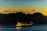 A fishing ship near Harstad in predawn light in winter, Arctic, Northern Norway.
