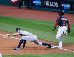 October 11, 2017 - Cleveland, OH, USA - New York Yankees first baseman Greg Bird makes the catch as the Cleveland Indians' Jose Ramirez, right, is out at first base in the first inning during Game 5 of the American League Division Series, Wenesday, Oct. 11, 2017, at Progressive Field in Cleveland. (Credit Image: © Leah Klafczynski/TNS via ZUMA Wire)