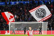09-04-2016 VOETBAL:PSV:WILLEM II:EINDHOVEN<br /> Het oude retro logo van PSV op vlaggen van supporters<br /> Foto: Geert van Erven