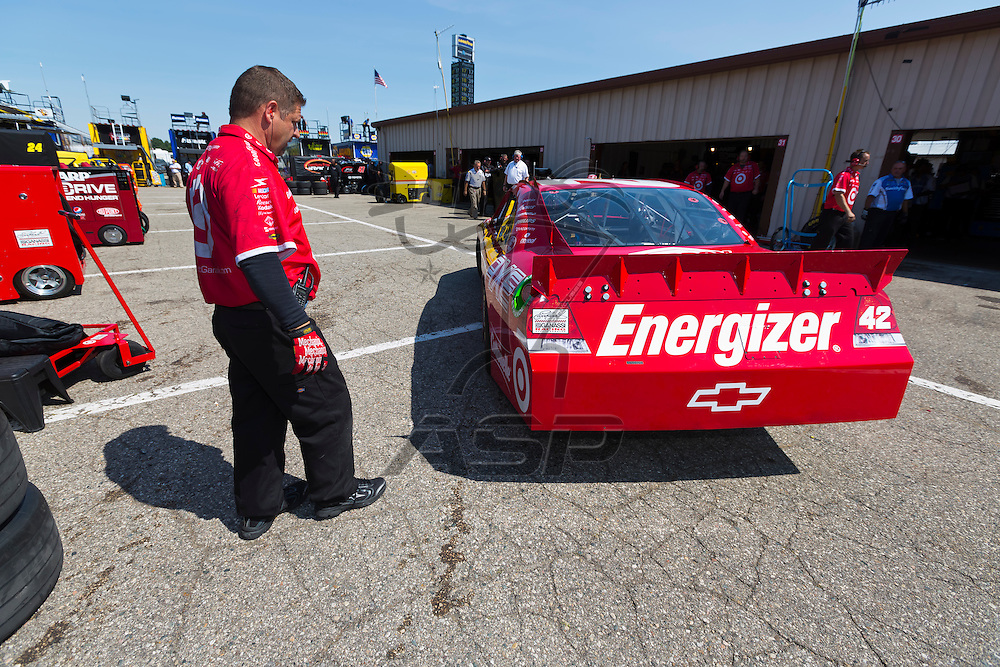 BROOKLYN, MI - JUN 15, 2012:  Juan Pablo Montoya (42) brings his car back into the garage area during a practice for the Quicken Loans 400 at the Michigan International Speedway in Brooklyn, MI.