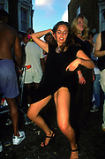 Girls dancing in the street Notting Hill Carnival London 1998