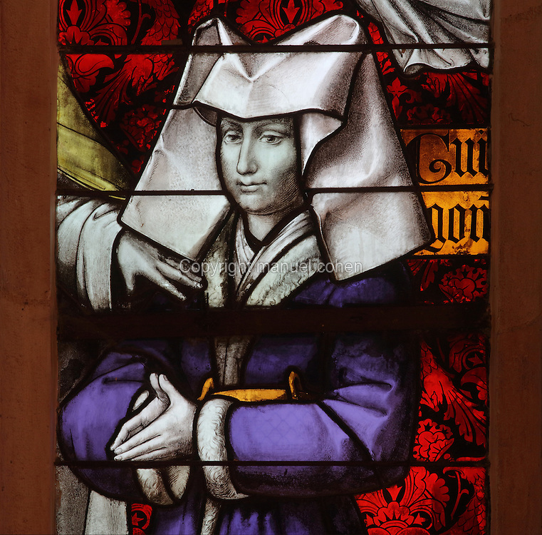 Guigone de Salins, 1403-70, with her coat of arms, detail from the stained glass window, 15th century, in the Chapel, in the Salle des Povres or Room of the Poor, in Les Hospices de Beaune, or Hotel-Dieu de Beaune, a charitable almshouse and hospital for the poor, built 1443-57 by Flemish architect Jacques Wiscrer, and founded by Nicolas Rolin, chancellor of Burgundy, and his wife Guigone de Salins, in Beaune, Cote d'Or, Burgundy, France. The hospital was run by the nuns of the order of Les Soeurs Hospitalieres de Beaune, and remained a hospital until the 1970s. The building now houses the Musee de l'Histoire de la Medecine, or Museum of the History of Medicine, and is listed as a historic monument. Picture by Manuel Cohen