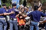 Roma 18 Giugno 2015<br /> Manifestazione degli Animalisti Italiani,  vicino all'ambasciata della Cina, per protestare  contro il  Festival di Yulin che si terrà il 21 giugno. Yulin è una metropoli cinese di 5 milioni e mezzo di abitanti, dove il 21 giugno di ogni anno, per il solstizio d'estate, si celebra un Festival per il quale vengono macellati e poi mangiati circa 10mila cani. Gli animalisti cercano di raggiungere l'ambasciata della Cina ma sono bloccati dalla polizia.<br /> Rome June 18, 2015<br /> Animal rights activists demonstrated, near the Embassy of China, to protest against the Festival of Yulin to be held on June 21. Yulin is a Chinese metropolis of 5 million and a half inhabitants, where on June 21 of each year, for the summer solstice, is celebrated a festival for which are then slaughtered and eaten about 10 thousand dogs. Animal rights activists are trying to reach the embassy of China but are blocked by the police.
