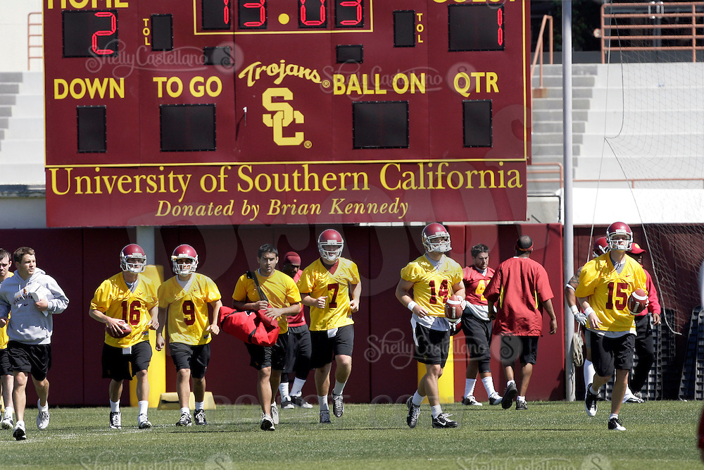 28 March 2009: 5 quarterbacks run the field together on the first day of '09 USC Trojans Pac-10 college football spring practice on campus in Southern California on a hot 81' sunny day.  #6 Chris McCaffery, #9 John Manooglan, #16 Mitch Mustain, #7 Matt Barkley, #15 Aaron Corp.