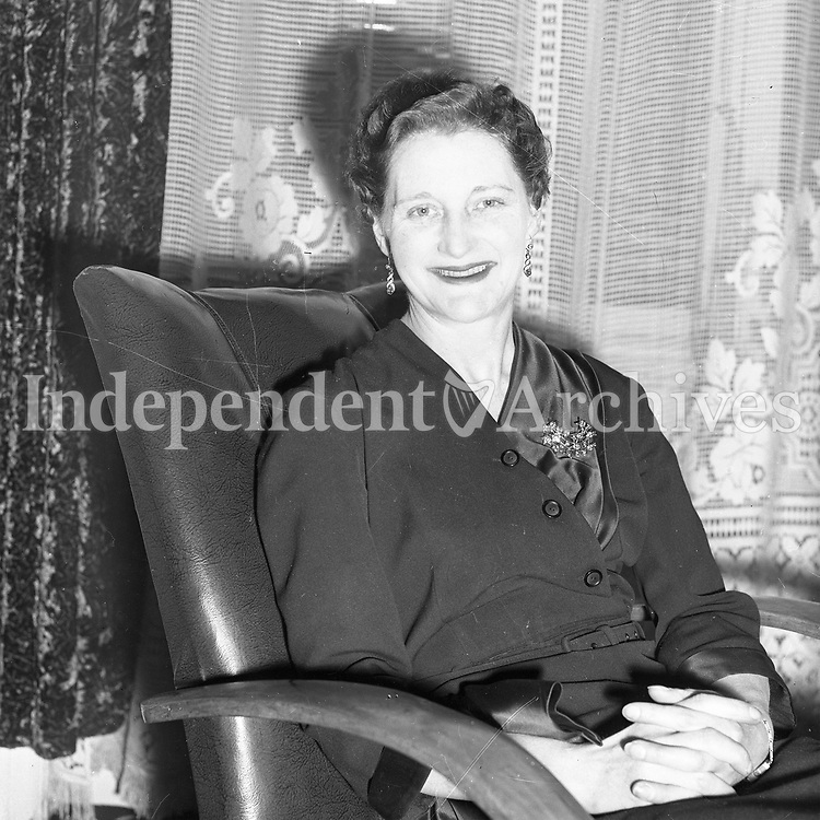 Picture of a lady sitting in a chair. Name, date and location unknown. <br />