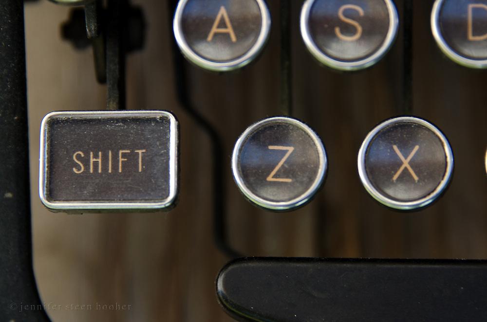 """Close-up of vintage typewriter """"shift"""" key."""