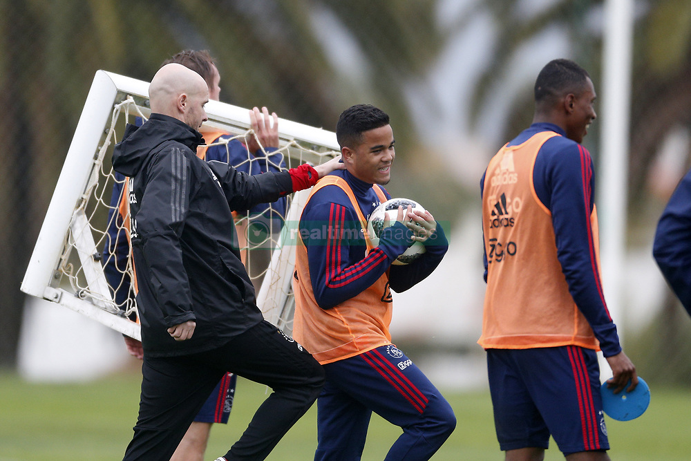 Justin Kluivert of Ajax (C), Coach Erik ten Hag of Ajax (L) during a training session of Ajax Amsterdam at the Cascada Resort on January 09, 2018 in Lagos, Portugal