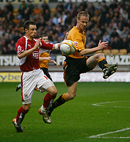 Photo: Steve Bond/Sportsbeat Images.<br /> Wolverhampton Wanderers v Bristol City. Coca Cola Championship. 03/11/2007. Darren Ward (R) clears in front of Michael McIndoe (L)