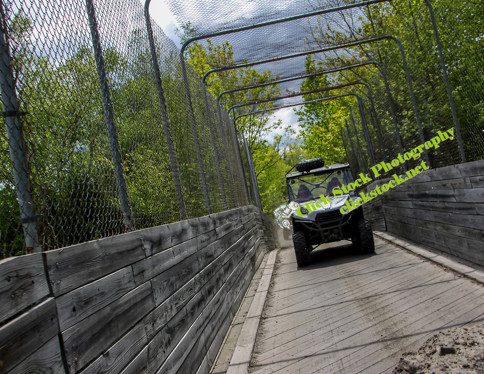 White Teryx on cage covered wooden bridge in NH, Teryx, Kawasaki, wooden bridge, cage covered bridge, NH, New Hampshire, New England, atv, utv, sxs, ohrv, orv, trail riding, hobby, adventure, sports, therapy, Click Stock Photography