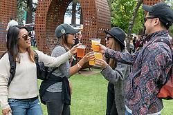 May 25, 2018 - Napa, California, U.S - Four friends share a toast during BottleRock Music Festival at Napa Valley Expo in Napa, California (Credit Image: © Daniel DeSlover via ZUMA Wire)