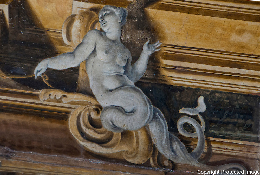 Detail of a trompe l'oeil painted ceiling decoration in a palazzo in Venice, Italy.