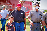 "06 AUGUST 2020 - FAIRFIELD, IOWA: People watch the bidding during the auction on the Adam Farm near Fairfield. Gary Adam, 72 years old, has been farming in the Fairfield area since 1971. He decided to retire this year because he wants to travel and because it's so difficult to make money in farming this year. He said he wants to ""shed the risk and responsibility. If things were super good, like they were 2006-2012, I might stay in it, but they're not."" An increasing number of farmers in the Midwest are retiring this year as it becomes harder to make money on crops. In addition to low prices, Iowa farmers are being hit with a drought this year, with well below average rain over most of the state. Because of the COVID-19 pandemic, the auction on Adam's farm was one of the first live in person auctions since winter. Most auctions are now done on line.     PHOTO BY JACK KURTZ"