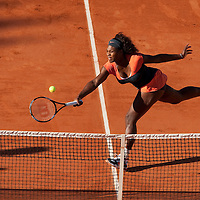 30 May 2009: Serena Williams of USA stretches for a forehand during the the Women's Third Round match on day seven of the French Open at Roland Garros in Paris, France.