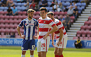 Middleton & Jacobs during the Sky Bet League 1 match between Wigan Athletic and Doncaster Rovers at the DW Stadium, Wigan, England on 16 August 2015. Photo by Simon Davies.