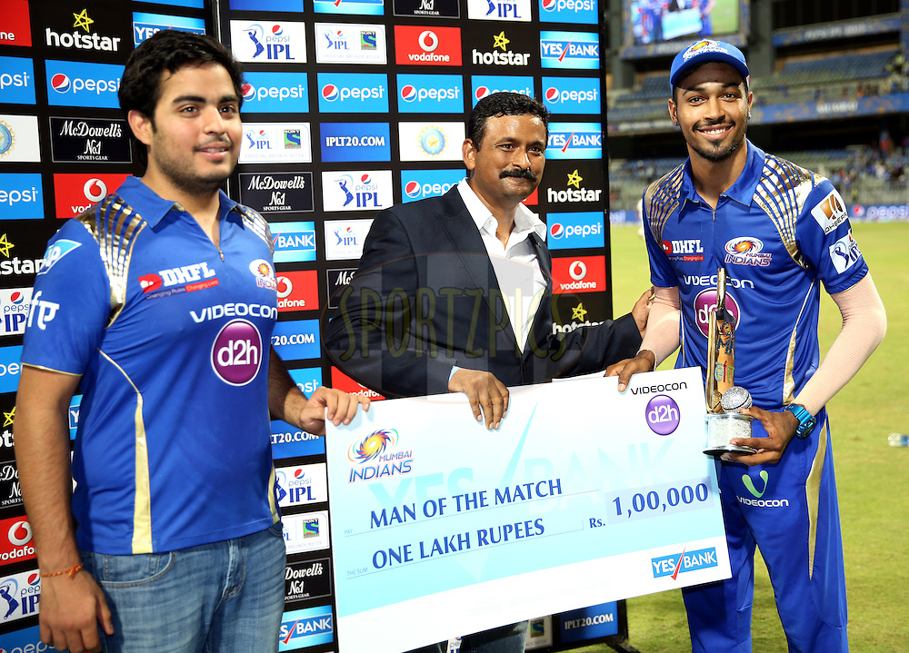 Mumbai Indians player Hardik Pandya  receives the man of the match award during the presentation of the match 51 of the Pepsi IPL 2015 (Indian Premier League) between The Mumbai Indians and The Kolkata knight Riders held at the Wankhede Stadium in Mumbai, India on the 14th May 2015.<br /> <br /> Photo by:  Sandeep Shetty / SPORTZPICS / IPL