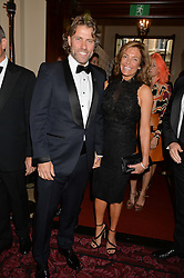 JOHN BISHOP and his wife MELANIE at the GQ Men Of The Year 2014 Awards in association with Hugo Boss held at The Royal Opera House, London on 2nd September 2014.