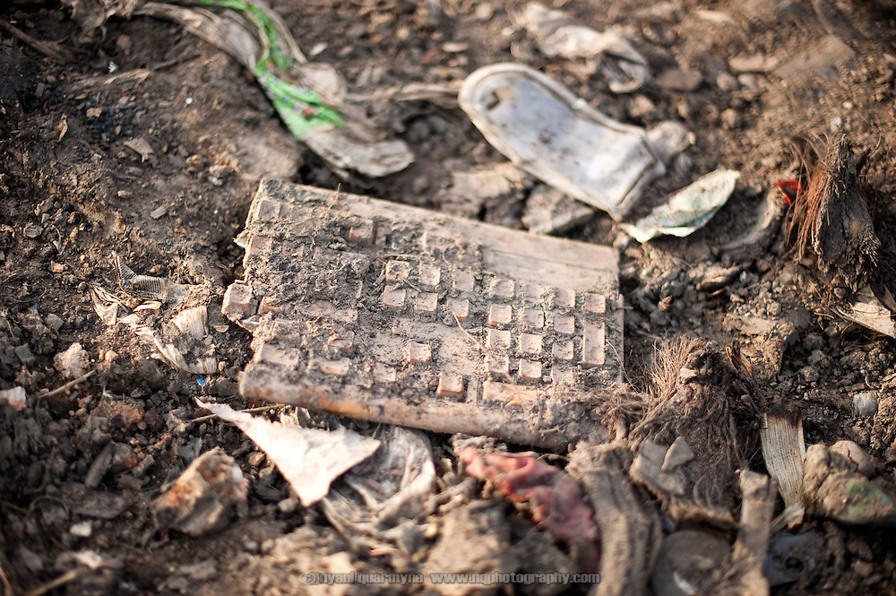 A broken keyboard lies on the ground in an area where 'e-waste' is salvaged in Old Fadama. The dumping of container loads of electronic waste under the guise of donations or sales of used computer equipment is a growing environmental problem, especially due to the heavy metals and other toxins for which no disposal facilities exist. Colloquially referred to as 'Sodom and Gomorrah, Old Fadama is located in Ghana's capital Accra and is home to some some 80,000 people.