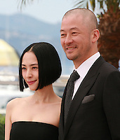 Actress Eri Fukatsu and actor Tadanobu Asano at the Journey To The Shore film photo call at the 68th Cannes Film Festival Sunday May 17th 2015, Cannes, France.