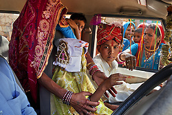 Family members escort the newly married Maya, 8, and Kishore, 13, to his family's home. They were married on the Hindu holy day of Akshaya Tritiya, which is said to bring good luck and is widely known in Rajasthan as the day for child marriages.