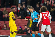 Sandro Scharer (Referee) talks with Paul-José M'Poku (Capt) (Liège) with Matteo Guendouzi (Arsenal) in the foreground during the Europa League match between Arsenal and Standard Liege at the Emirates Stadium, London, England on 3 October 2019.