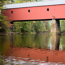 Sawyer's Crossing Covered Bridge spans the Ashuelot River in Keene, New Hampshire.