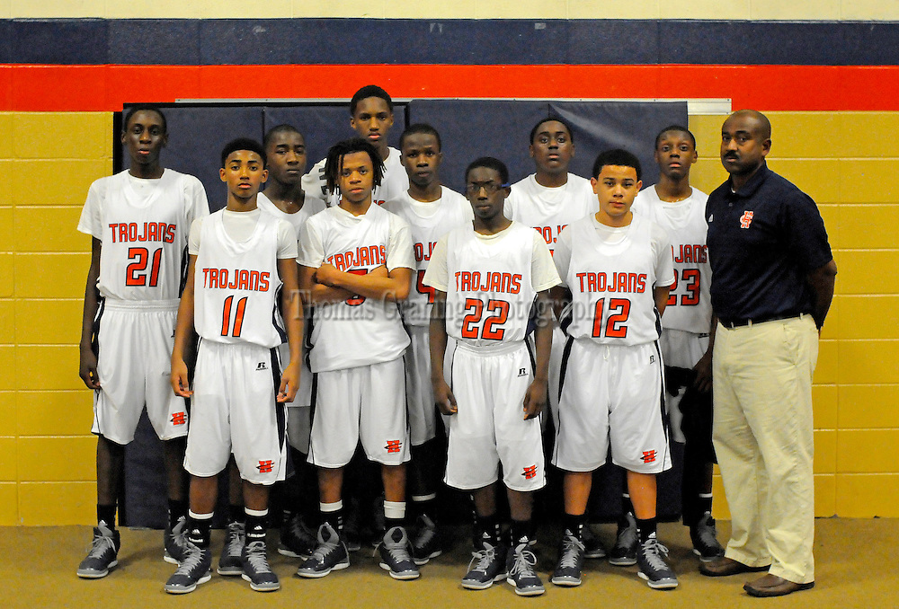 Members of the Charles Henderson High School eighth-grade basketball team pose for a photo after a basketball game in Troy, Ala., Thursday, Dec. 20, 2012. (Photo/Thomas Graning)