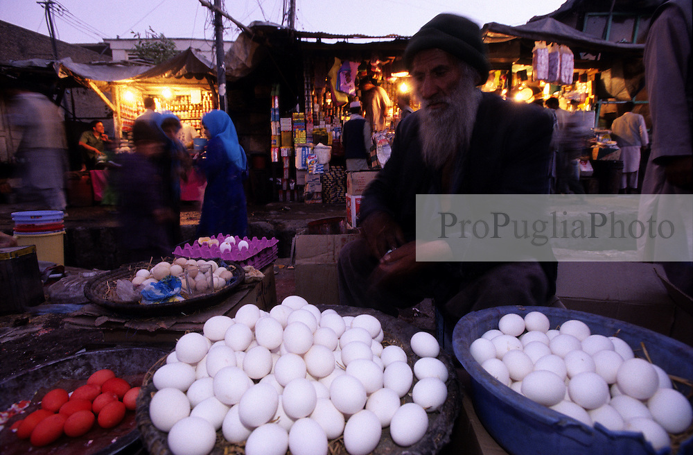 A old man selling eggs in the bazaar. ..The cost of life is becoming extremely high for the ordinary people