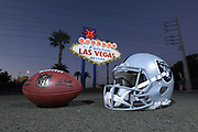 General overall view of Raiders helmet and NFL Wilson official Duke football  in front of the Welcome to the Fabulous Las Vegas sign on Las Vegas Blvd. on the Las Vegas strip in Las Vegas, Tuesday, Sept. 25, 2018. The Raiders will relocate from Oakland to Las Vegas for the 2020 season.