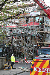 © Licensed to London News Pictures. 27/11/2015. London, UK. A workman looks at the remains of a collapsed building in Barnes.  The Georgian townhouse collapsed as workmen were extending the property, which reportedly belongs to business man David Kassler . Singer Duffy was a previous occupant. Photo credit: Peter Macdiarmid/LNP