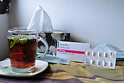 A medical face mask, a pack of Tamiflu tablets, tissues and a cup of hot mint tea agaist Swine flu, October 30, 2009.