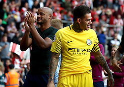 Manchester City goalkeeper Ederson (right) and Manchester City's Vincent Kompany (left) after the final whistle during the Premier League match at St Mary's Stadium, Southampton.
