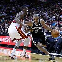 17 January 2012: San Antonio Spurs point guard Tony Parker (9) drives past Miami Heat point guard Norris Cole (30) during the Miami Heat 120-98 victory over the San Antonio Spurs at the AmericanAirlines Arena, Miami, Florida, USA.
