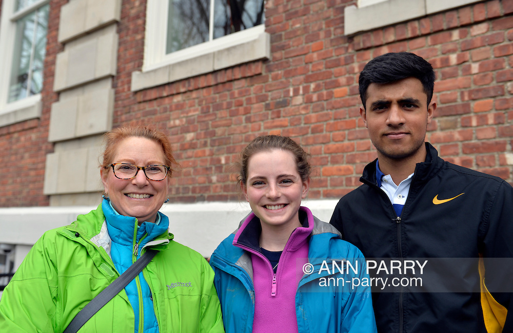 Port Washington, New York, USA. 11th April 2016. L-R, PATRICIA BRIDGES, MAGGIE BRIDGES her 17-year-old daugher in 11th grade, and QASIM IQBAL, 18 years old and in 12th grade, are waiting on line to attend a Hillary Clinton, Democratic presidential primary leading candidate, discussion on gun violence prevention with  activists who lost family members due to shootings. Hillary Clinton, the former Secretary of State and U.S. Senator from New York,  wants tougher gun control legislation. New York presidential primary is April 19.