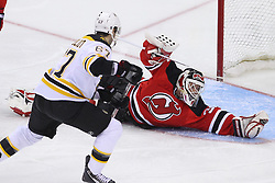Jan 19; Newark, NJ, USA; New Jersey Devils goalie Martin Brodeur (30) makes a save on Boston Bruins left wing Benoit Pouliot (67) during the third period at the Prudential Center.   The Bruins defeated the Devils 4-1.