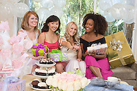Bride sitting  together with her Friends showing engagement ring at Bridal Shower