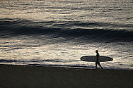 Surfer in front of the condo, Monday, November 16, 2015. (Trevor Hagan)