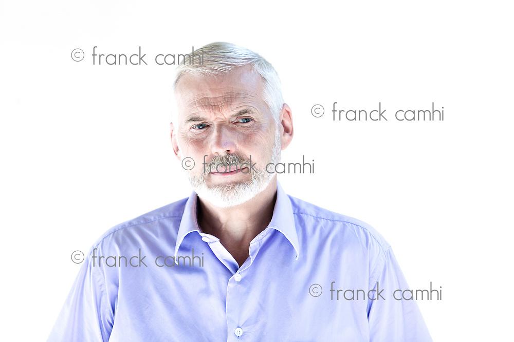 caucasian senior man portrait frown sullen isolated studio on white background