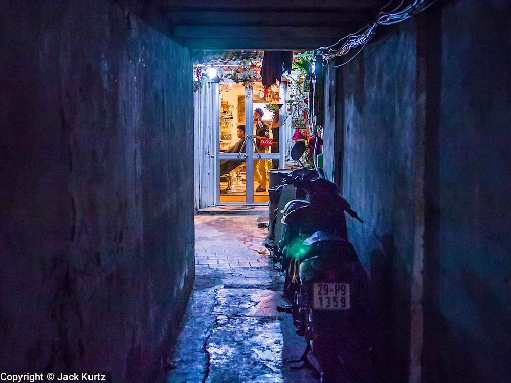 07 APRIL 2012 - HANOI, VIETNAM: A barber shop at the end of an alley in Hanoi, the capital of Vietnam. Hanoi is one of the oldest cities in Southeast Asia. It was established in 1010 A.D.   PHOTO BY JACK KURTZ
