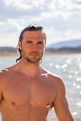 good looking shirtless man in a lake