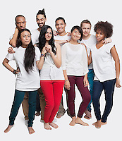 Portrait of young multi-ethnic friends posing together against white background