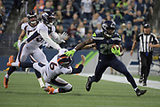 Aug 8, 2019; Seattle, WA, USA;Seattle Seahawks cornerback Ugo Amadi (28) is pursued by Denver Broncos punter Colby Wadman (6) on a punt return in the third quarter  at CenturyLink Field. The Seahawks defeated the Broncos 22-14.