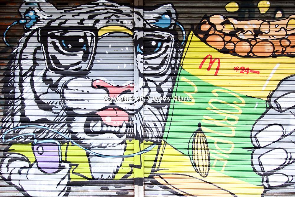 Tiger holding McDonald's Corn Pie, Charoen Krung Road, Bangkok
