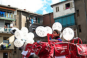 A child from the Scampia football school represents the school on the top of their float