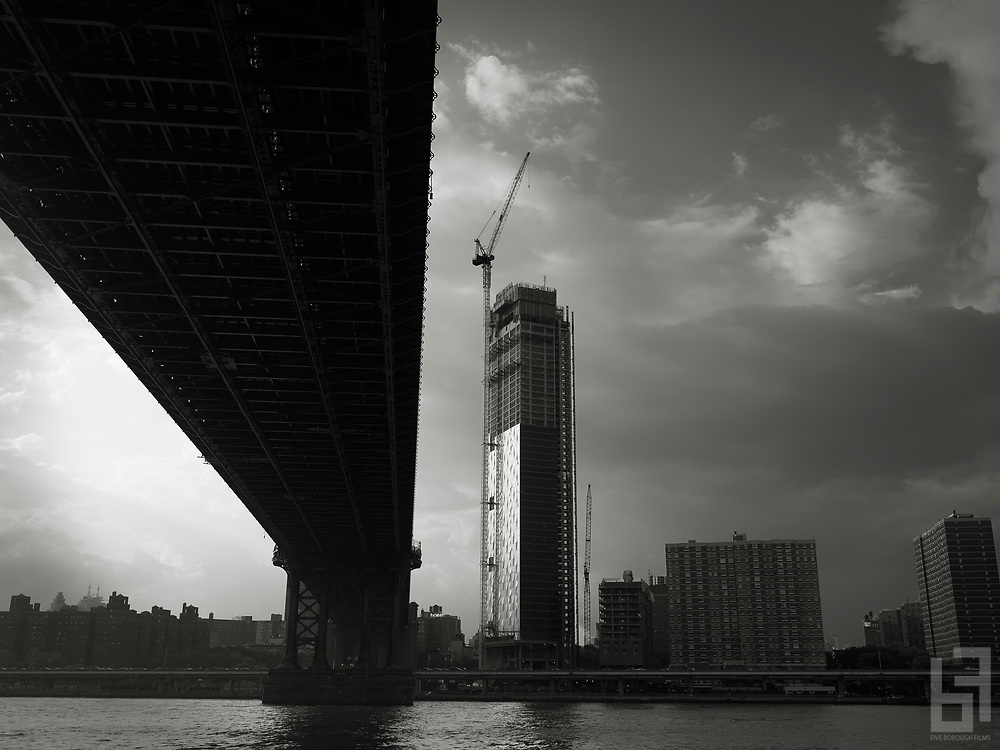 One Manhattan Square under construction on the east river.  The condominium project, developed by Extell and designed by Adamson Associates will rise to a height of 847 feet alongside the Manhattan Bridge.