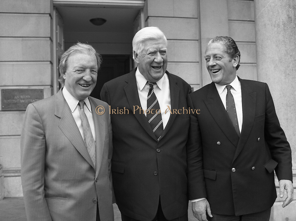 Tipp O'Neill At Iveagh House, Dublin.  (R61)..1987..10.07.1987..07.10.1987..10th July 1987..Mr Tipp 'Neill, Speaker of the House of Representatives in Washington DC paid a courtesy call at Iveagh House, Dublin today. Mr O'Neill was the guest of honour at a luncheon hosted by An Taoiseach, Charles Haughey and An Tanaiste, Brian Lenihan...Posing for the media on the steps of Iveagh House were ; An Taoiseach, Mr Charles Haughey, Mr Tipp O'Neill and An Tanaiste, Mr Brian Lenihan.