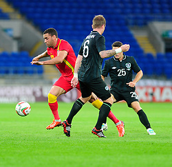 Hal Robson-Kanu of Wales (Reading) passes Glenn Whelan of Republic of Ireland (Stoke City)  - Photo mandatory by-line: Dougie Allward/JMP - Tel: Mobile: 07966 386802 14/08/2013 - SPORT - FOOTBALL - Cardiff City Stadium - Cardiff -  Wales V Republic of Ireland - International Friendly