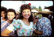 Girls dressed as Brazilian hillbillies prepare to dance quadrilha at Festa Junina (June Fest) celebration on Carvalho ranch near Eirunepe, Brazil.