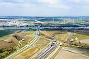 Nederland, Zeeland, Zeeuws-Vlaanderen, 01-04-2016; Sluiskiltunnel, Kanaal Gent-Terneuzen, kanaalkruising Sluiskil. In de achtergrond de brug in de N61 die in het verleden regelmatig voor files zorgde als er zeeschepen doorgelaten moesten worden.<br /> Slusikil tunnel, replacing the pivot bridge over the canal Gent-Terneuzen (Zeeland).<br /> luchtfoto (toeslag op standard tarieven);<br /> aerial photo (additional fee required);<br /> copyright foto/photo Siebe Swart