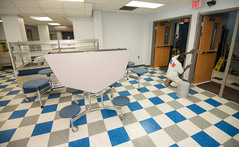 Workmen put finishing touches on renovations at Eastwood Academy High School.